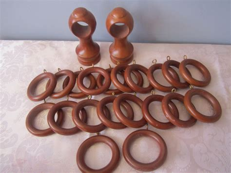 20 wooden 2 1 4 inch curtain rings and 2 curtain rod holders