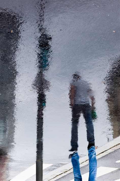 photography rain reflection street photography umbrellas