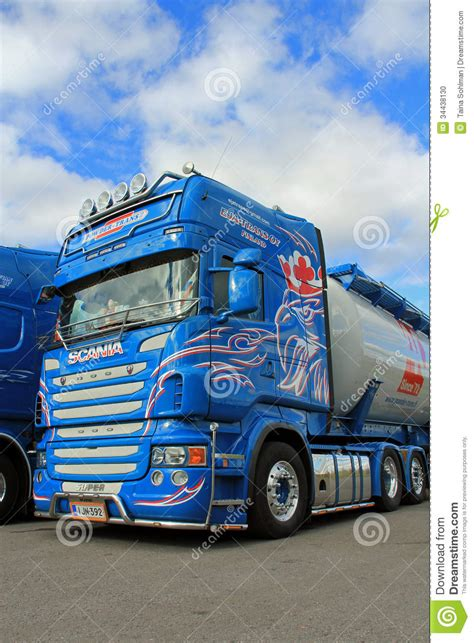 blue scania truck detail  blue sky  clouds