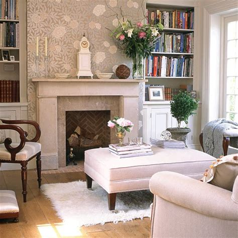 period homes and interiors magazine neutral room with floral feature wall bookcases