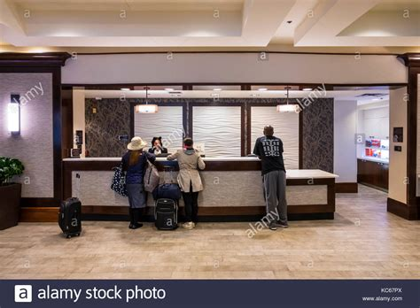hilton employee help desk at a reception at the hilton hotel stock photos at a