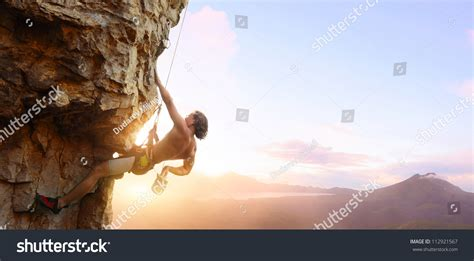 Young Man Climbing Vertical Wall Belay Stock Photo