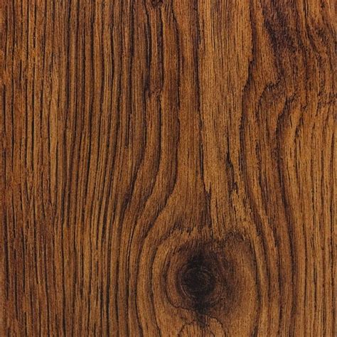 scraped oak laminate flooring hton bay hand scraped oak burnt caramel 8 mm thick x 5 1 2 in wide x 47 7 8 in length
