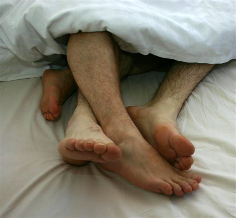 couples in bed cuddling