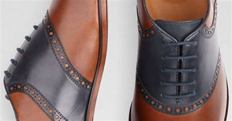 navy leather florsheim saddle shoes with a cognac and