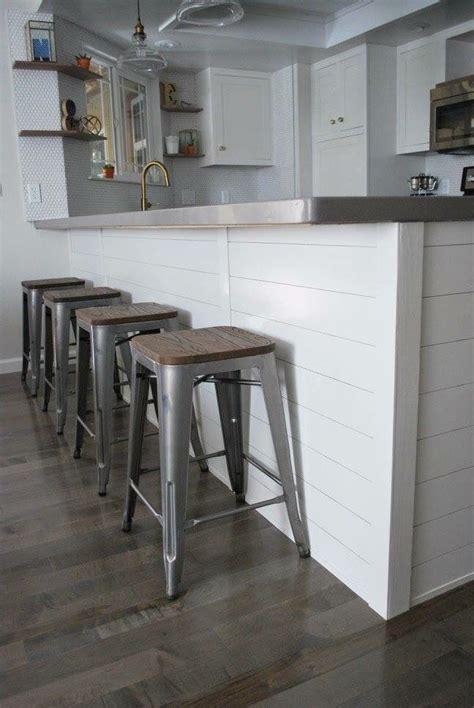 shiplap siding wrapping  kitchen island stools