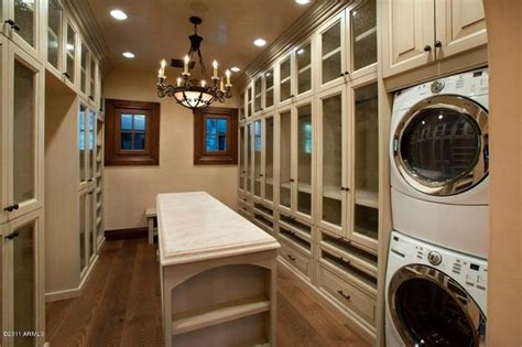 closet with the washer dryer in it bedroom