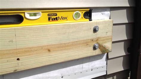vinyl wood siding diy deck building ledger attachment part 3