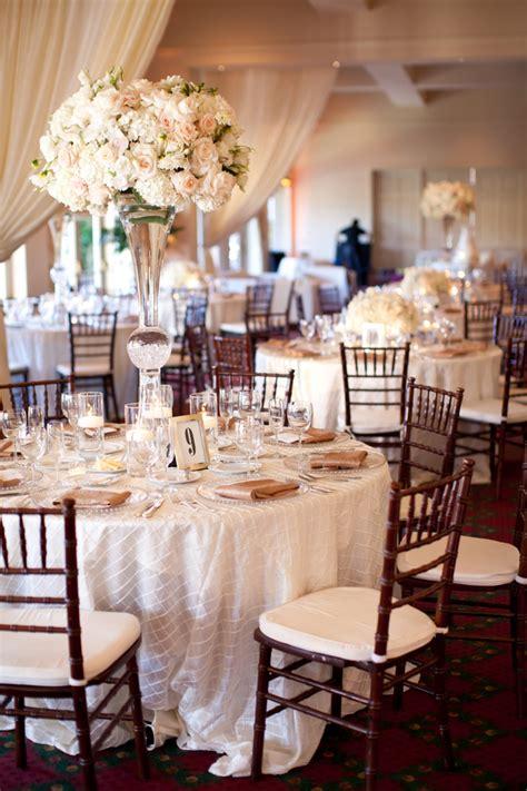 tall cream  blush reception floral arrangements
