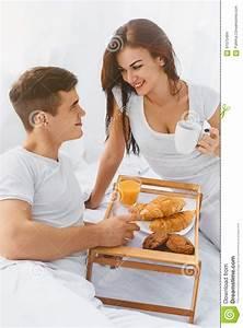 Couple Having Breakfast In Bed Stock Photo - Image: 61075484