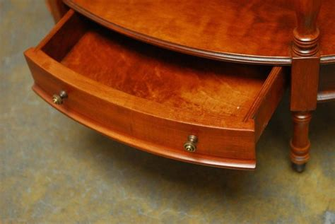 two tier oval side table with brass l by frederick