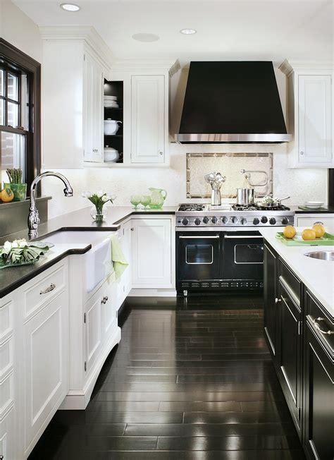 kitchen black range stove hood custom dark wood floors