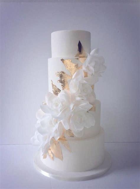 stunning cascading wafer paper roses  gold leaf wedding cake