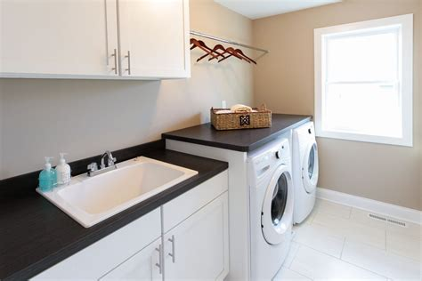 Laundry Sink Countertop contemporary laundry room with travertine tile floors