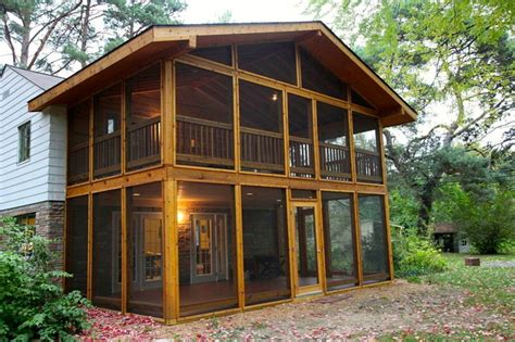 two story enclosed patio rustic porch detroit by
