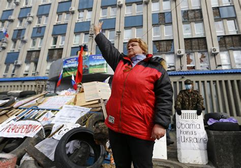A Pro Russian Protester Gestures At A Barricade In Front