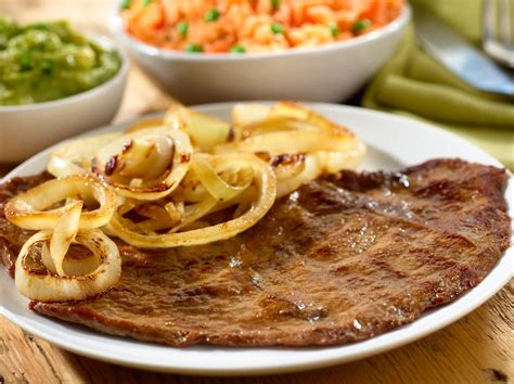 Beef slices cooked in soy sauce with lemon and onions. 10 Best Beef Round Steak Quick Recipes