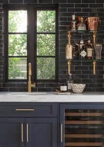 black glass tiles for kitchen backsplashes glossy black bar backsplash with glass and brass shelves contemporary kitchen