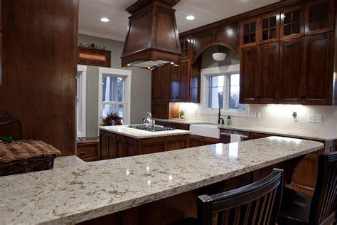 kitchen slab fantastic wooden range hood over island with black stove top and white cambria quartz granite