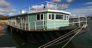 Old Boat Turned Into House by River Hamble Barge Once Used As A Cargo Ship Is