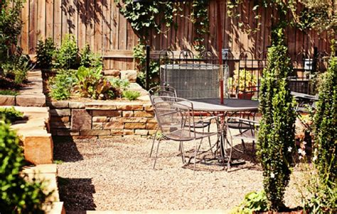 pea gravel patio landscaping and raised flower beds