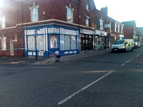 Woman stabbed in the stomach on a Wigan street - man ...