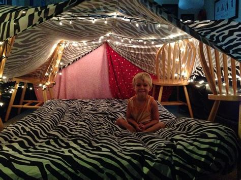 rainy day blanket fort tie string to two ends of the room