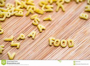 alphabet shaped pasta forming the word food stock photo With letter shaped pasta