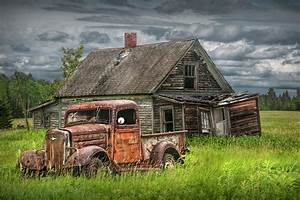 Old Abandoned Pickup By Run Down Farm House Photograph by