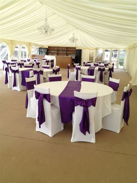 cadbury purple satin sashes with white covers like the satin on the table prefer organza