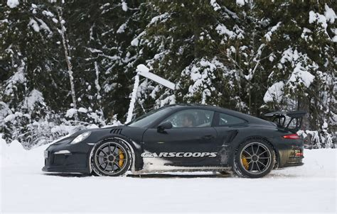 new porsche 911 gt3 rs new porsche 911 gt3 rs spied dancing in the snow carscoops