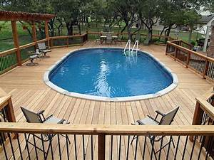 Outdoor above ground pool with deck above ground pool for Above ground swimming pool deck designs