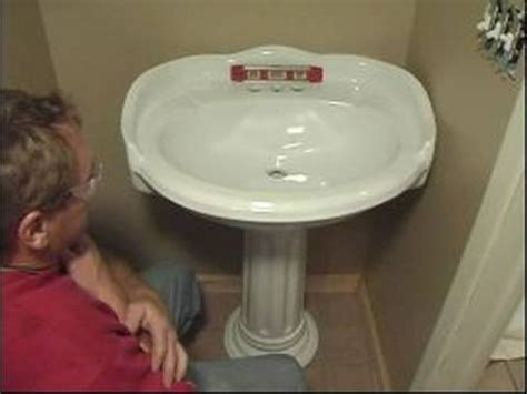 how to attach a pedestal sink to the wall how to install a pedestal sink how to level a sink for