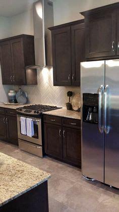 brown kitchen cabinets tile backsplash with giallo ornamental granite countertops 6421