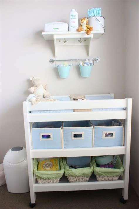 changing table organization ideas love the idea of hanging pales above changing table to
