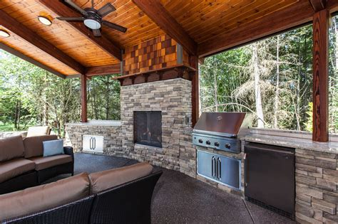 covered outdoor living area with grill refrigerator and