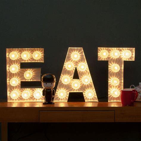 eat light  fairground bulb sign  goodwin goodwin
