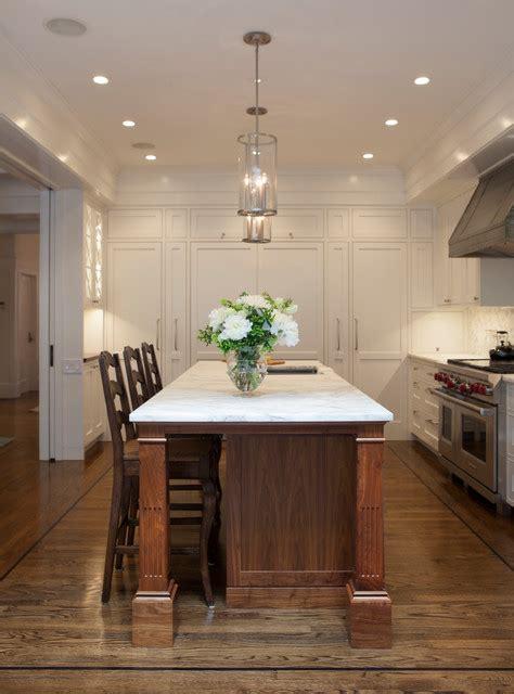 black walnut kitchen island  white marble countertops traditional kitchen san