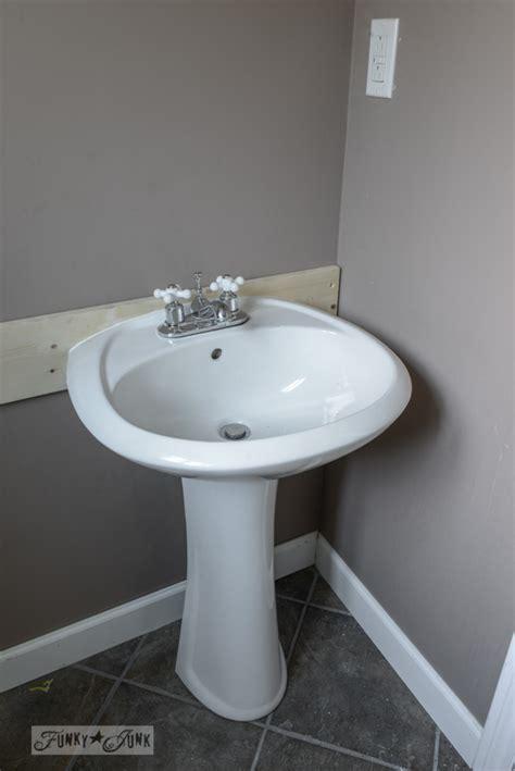 install  pedestal sink  wall studsfunky