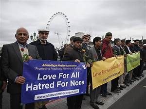 Young Muslims and police gather on Westminster Bridge to ...