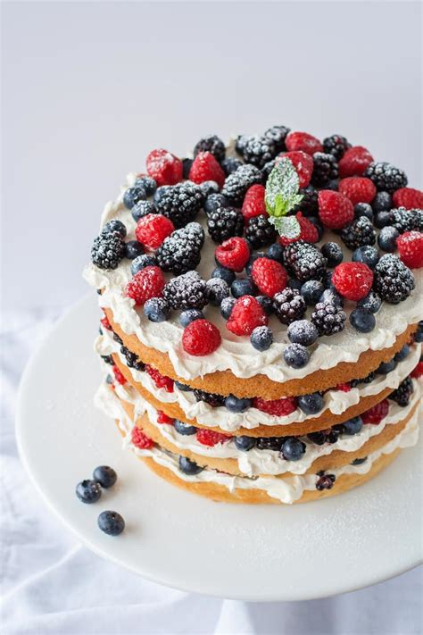 orange layer cake  buttercream frosting  berries