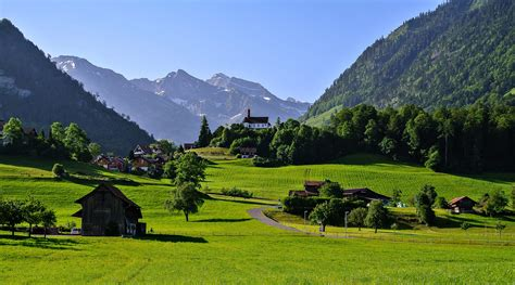 Switzerland town countryside landscapes houses trees grass ...