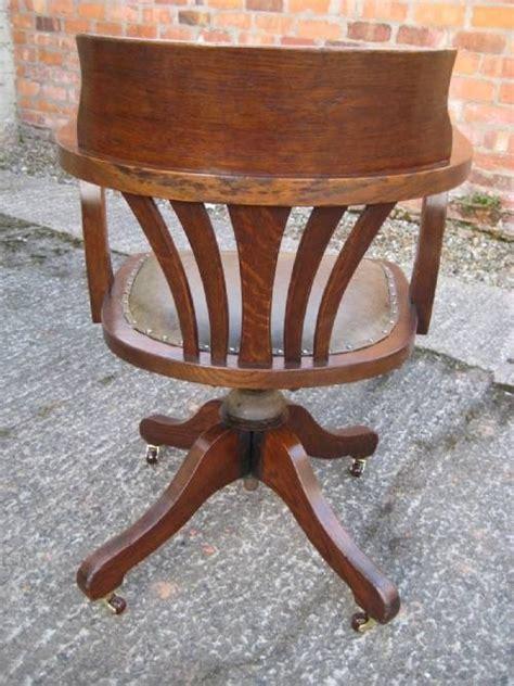 oak captains style swivel and tilt desk chair 44729