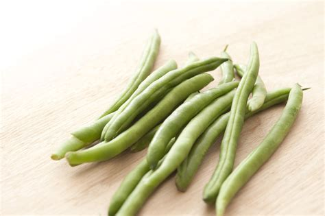 green beans  wooden table  stock image