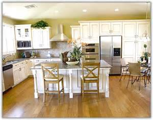 colorful kitchen knives white kitchen cabinets light wood floor home design ideas