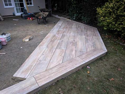 rotten decking replaced  wood effect porcelain paving