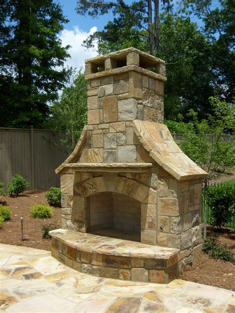 outdoor stack stone fireplace  flagstone decking