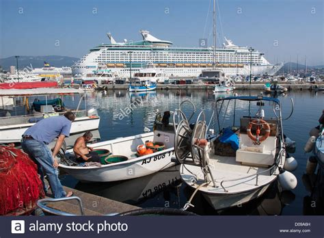 Fishing Boat Cruise by Contrast Between Small Fishing Boats Immense Cruise Ship