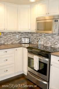 oak kitchen remodel painted cream cabinets and quartz