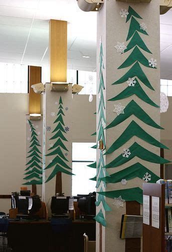 office door christmas decorating ideas 4 calling birds decorate the office with paper trees on pillars and walls office office